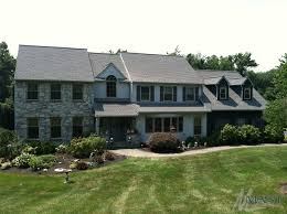 House With A New Shingle Roof