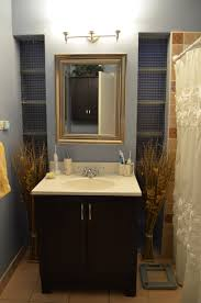 traditional black bathroom. Bathroom. Black Wooden Vanity With Storage Also White Counter Top And Sink On The Cream Traditional Bathroom