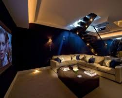 exterior: Chic Home Theater Design With Cozy Couch Front Flowers On Brown  Table Plus Cute
