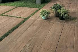outdoor flooring over grass wood look outdoor tile as stepping stones or a garden path outdoor