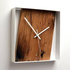 brown og square wooden wall clock