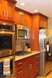 cherry kitchen cabinets black granite. Cherry Kitchen Cabinets At Impressive S Black Granite Backsplash With Quartz Countertops