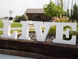 close up of standing foam letters with garden spikes