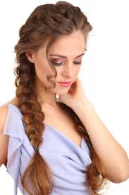 the big full loose side braid hairstyle