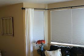 bay window curtain poles for eyelet curtains elegant rod you can add stainless on hanging rods close to ceiling