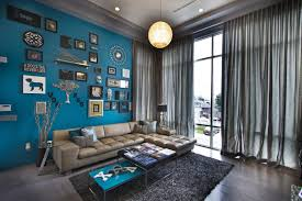 unique gallery wall ideas behind sofa with blue decor and brown leather sofa also using ball pendant light shades