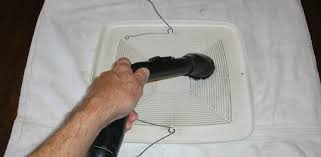 use a dusting brush on a vacuum to clean vent fan cover