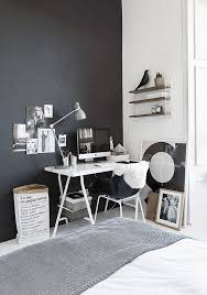 home office wall. The Home Office Nook Is Defined By A Black Wall And Matching Chair To Visually