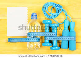 gym and workout concept mering tape dumbbells jump rope top view sports equipment in cyan blue near blank sheet image