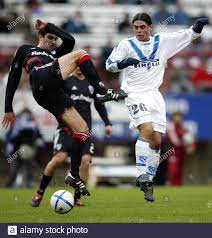 Lucas Castroman (L) of Argentine club Velez Sarsfield fights for the ball  with Sergio Rodriguez of Uruguayan club Danubio during the first half of  their Libertadores Cup soccer match in Montevideo February