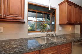 stainless steel kitchen sink under bay window