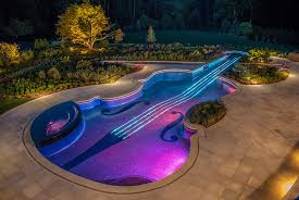 custom swimming pool designs. View In Gallery Award Winning Stradivarius Violin Pool Cipriano Landscape Design 1 %20blue Purple Lights Thumb 630xauto 32164 Custom Swimming Designs E