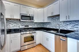 backsplash with white cabinets and black countertops kitchen ideas black granite white cabinets white kitchen cabinets