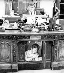 Jfk years in office Born Iconic Photos Iconic Photos Wordpresscom John F Kennedy Jnr Under The Resolute Desk Iconic Photos