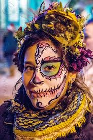 woman with sugar skull half face makeup dia de los muertos day of