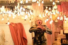 kristen wiig s to sia s chandelier at the 57th grammy awards kevork djansezian getty