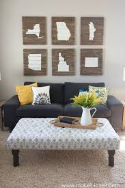 awesome living room with loveseat and tufted ottoman coffee table also wall art and area rug