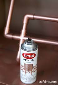 Once she assembled the pipes, she spray-painted the fixture a copper hue.