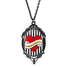 freak show cameo necklace with black filigree frame on a 18 chain