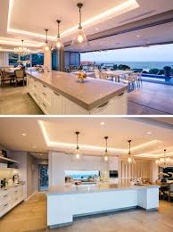 view modern house lights. Exellent Lights In This Modern Kitchen A Long White And Grey Island Sits Below Three Glass  Pendant Intended View Modern House Lights V