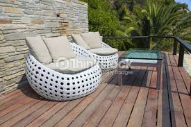 white garden furniture. White Outdoor Furniture On Wood Resort Terrace : Stock Photo Garden