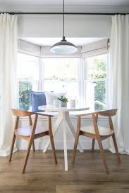 Give a plain bay window a designer boost by installing outside-mount Roman  shades on