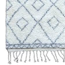 gray rug the subtle diamond graphic and chunky fringe makes it both versatile edgy moroccan bath
