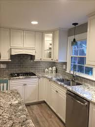 kitchen tile. stunning remodeled kitchen using ice gray glass subway tile backsplash. https://www