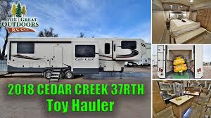 new luxury toy hauler 2018 cedar creek 37rth rear garage front living room fifth wheel colorado