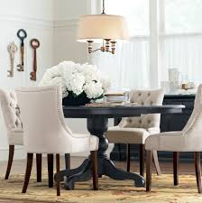 love the black table paired with white tufted chairs diningroom
