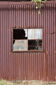 old rusty tin corrugated iron metal shed with window
