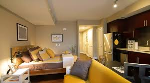 bedroom track lighting. one bedroom apartment decorating with yellow sofa and sliding over bed table also ceiling track lighting spotlight