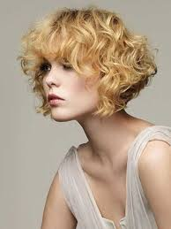 short curly permed hairstyle with long bangs