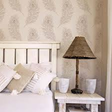 the designer peacock allover wall pattern from cutting edge