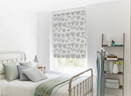 here flora garden gives this relaxing bedroom a focal point set against white walls this blind sets our heart aflutter