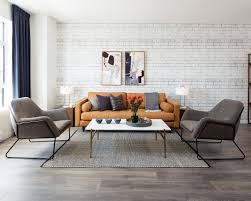 spacious wide plank laminate main floor showcasing the bright open concept living room dining room and kitchen layout at one end sliding glass doors