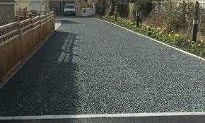 domestic gravel driveway installation using black x grid panels