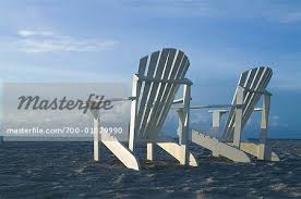 adirondack chairs on beach. Adirondack Chairs On Beach - Stock Photo .