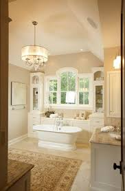 traditional bathroom lighting. storage behind bathtub bathroom traditional lighting