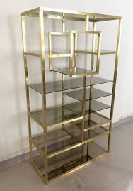 polished brass tinted glass shelving unit