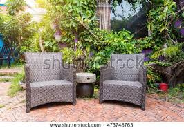 flourishing garden. Cozy Wickers Chair In Beautiful Flourishing Garden A