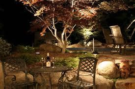 outdoor lighting idea. Contemporary Outdoor Lighting On Tree Idea Feat Cozy Metal Chairs And Rock Garden Design \u2026