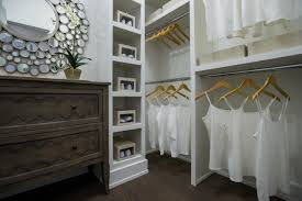 bedroom walk in closet off master bedroom small nightstand under cool bed lamp large smooth