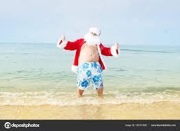 funny santa shorts beach stock photo