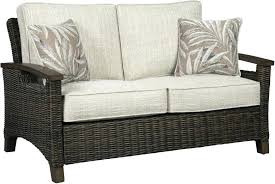 outdoor loveseat cushions signature design by paradise trail medium brown with cushion clearance