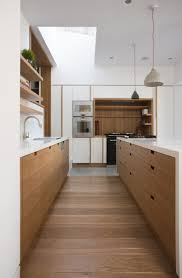 kitchen wood furniture. Architect Peter Legge Uses Rectangular Cutouts In A Wood And White Kitchen Dublin See The Rest Of Project Victorian Transformation Furniture