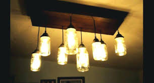 diy mason jar chandelier how to make a mason jar chandelier with wood projects diy mason