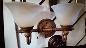 progress lighting savannah vanity light in burnished chestnut p3205 86