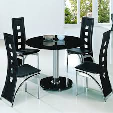 black round table. Planet Black Round Glass Dining Table With Alison Chairs