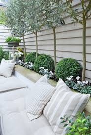 courtyard furniture ideas. courtyard for planter along bench seating and olive trees by claire mee garden design furniture ideas r